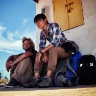 Blue skies, backpacks, weary travelers